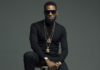 Dressed in black, Nigerian singer D'banj posing for a picture in the studio