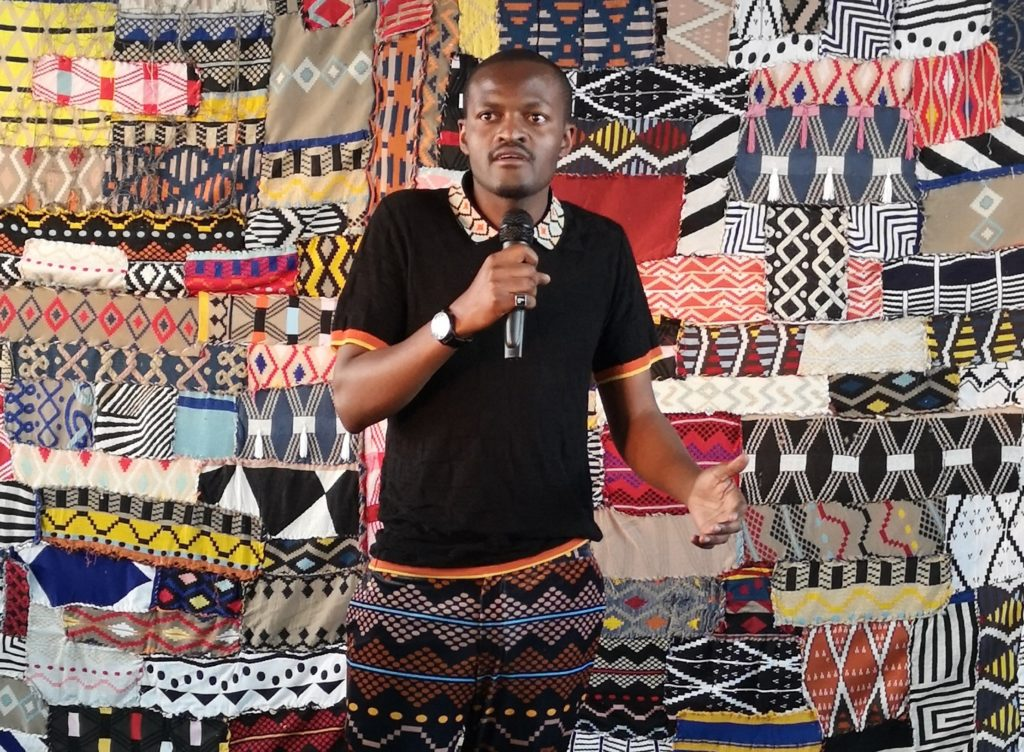 Designer Laduma Ngxokolo addressing guests at the unveiling of Maxhosa Africa studio in Johannesburg