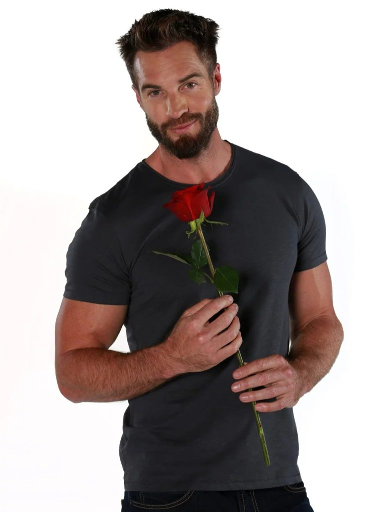 Holding a red rose in his hands, Marc Buckner is South Africa's newest Bachelor looking for love