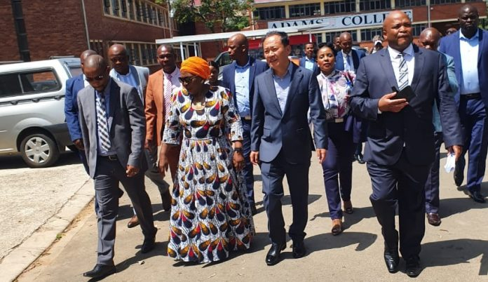 Samsung South Africa representatives led by its CEO Sung Yoon walk out of a meeting with Department of Education officials