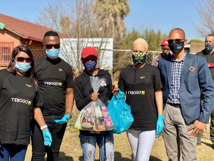 Mama Meet The One cast members holding food parcels to be donated to the needy